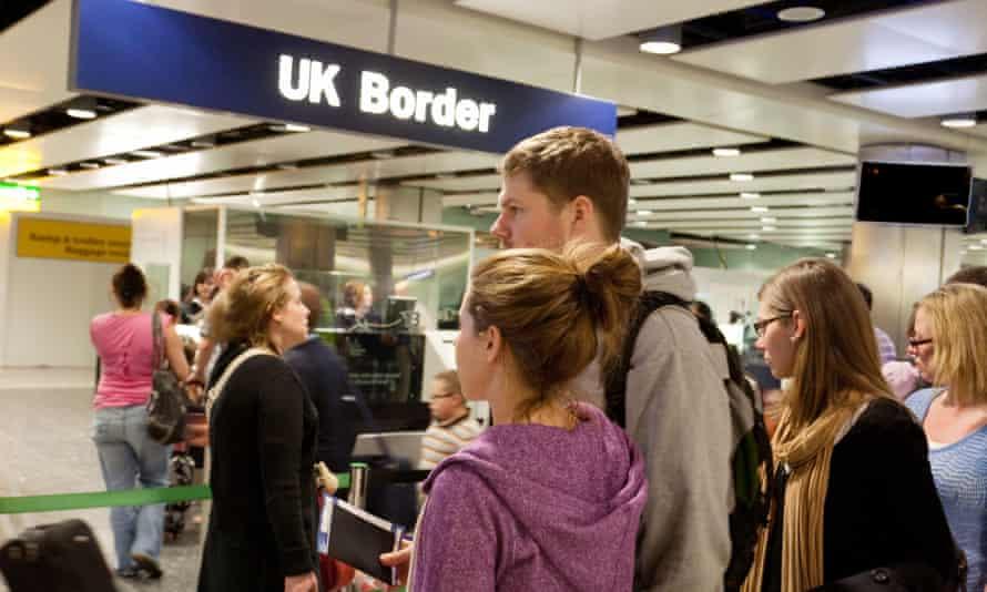 People at UK border control at Heathrow airport.