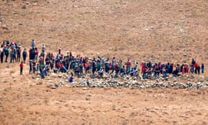 Syrian refugees approach the border fence with Israel last week.