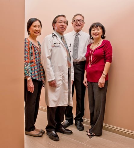 Back to business: Dr Hung Nguyen, who now lives and works in Los Angeles, with his family.
