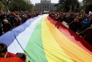 Vienna, Austria. Participants of the traditional May Day celebrations, organised by the Austrian Social Democrats, SPOE, and trade unions carry a rainbow flag through the city