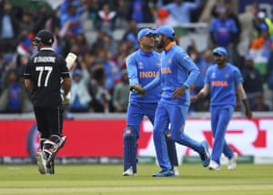 Dhoni celebrates after taking the catch to dismiss De Grandhomme.