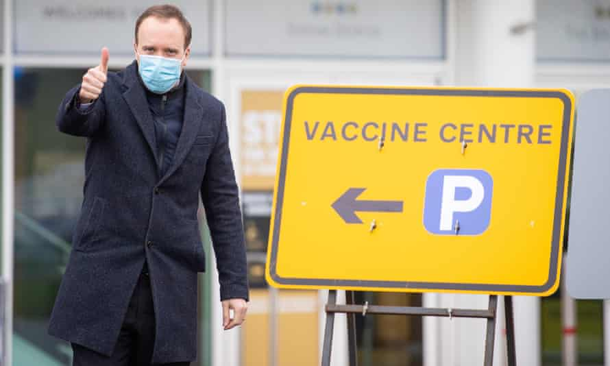 Matt Hancock wearing a zip-up top at a vaccination centre