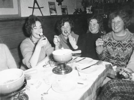 Tremain, far left, eats fondue with friends in the 1960s
