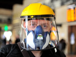 A tourist wears an industrial mask at Santa Maria Novella station in Florence