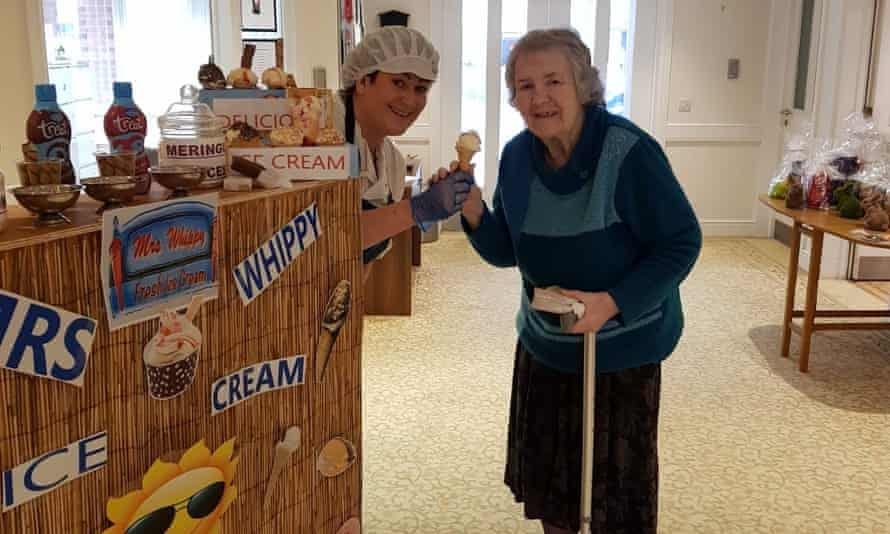 A resident enjoys a makeshift ice-cream van at West Farm Care Centre in Newcastle.