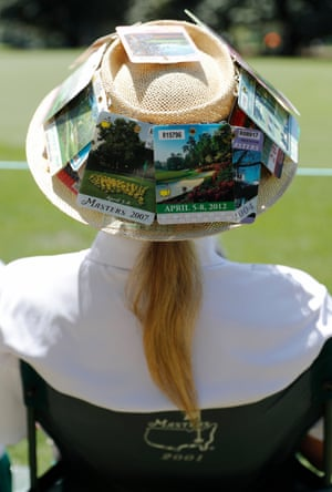 A patron wears a hat adorned with previous years' badges