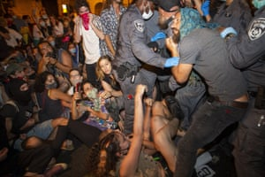 Police scuffle with demonstrators
