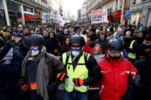 Protesters wearing yellow vests and demonstrators attend a demonstration during a national day of protest by the 'yellow vests' movement in Paris