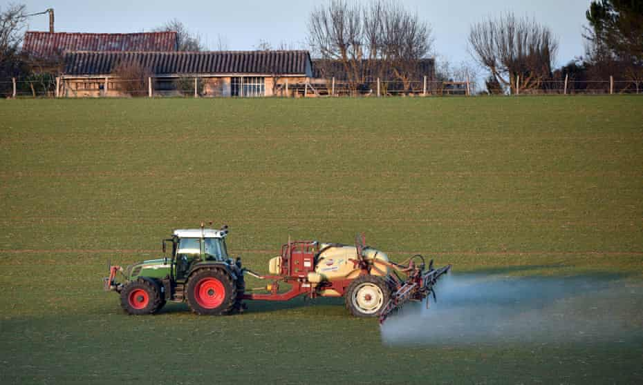A farmer spreads pesticides on a field in Fromelles near Lille, France
