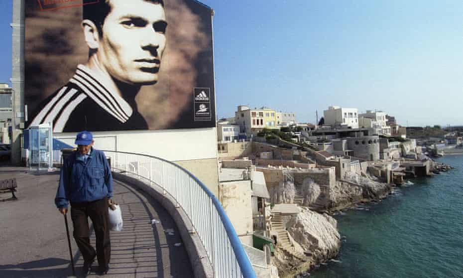 A giant poster of French soccer player Zinedine Zidane on the seafront in Marseille.