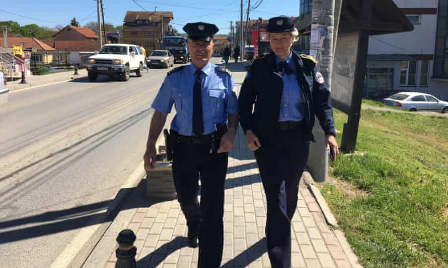 Svetlana Kapetanović, with her colleague Isak Hertica, has learned Alabanian to help her better police the town of Gračanica.
