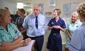 Boris Johnson with NHS staff on a hospital visit