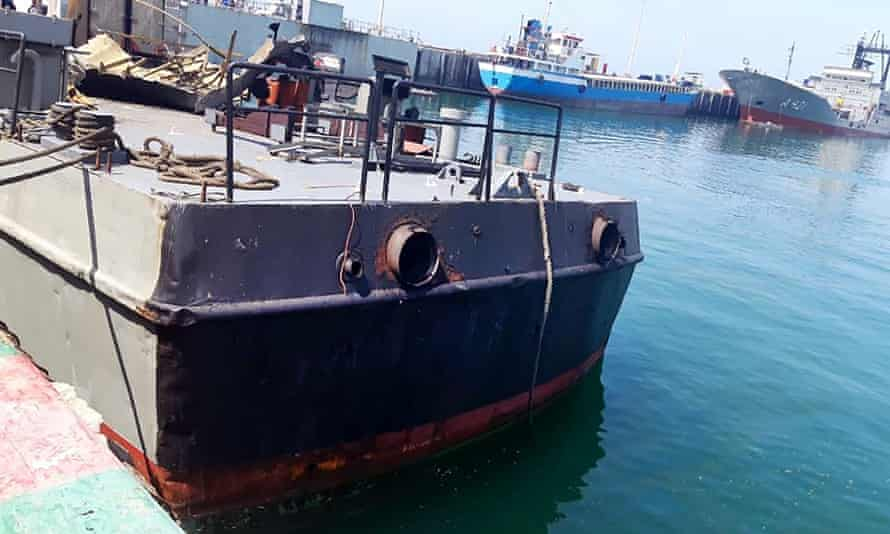 A handout picture provided by an Iranian army official website shows the damaged Konarak vessel docked after the friendly fire incident.