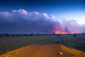 Smoke and fire is seen in the distance near Rainbow Flats, NSW