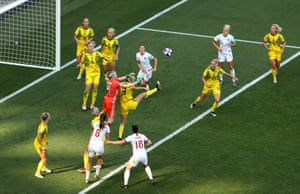 Sweden keeper Hedvig Lindahl and Linda Sembrant go for the ball.