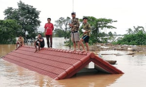 Villagers are stranded on a roof of a house