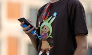 A person plays the augmented reality mobile game Pokémon Go at Puerta del Sol square in Madrid, Spain.