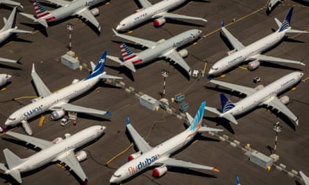 Boeing 737 Max aircraft recalled to the company's Seattle base in 2019 after two of the planes crashed. That grounding has compounded Boeing's latest losses.