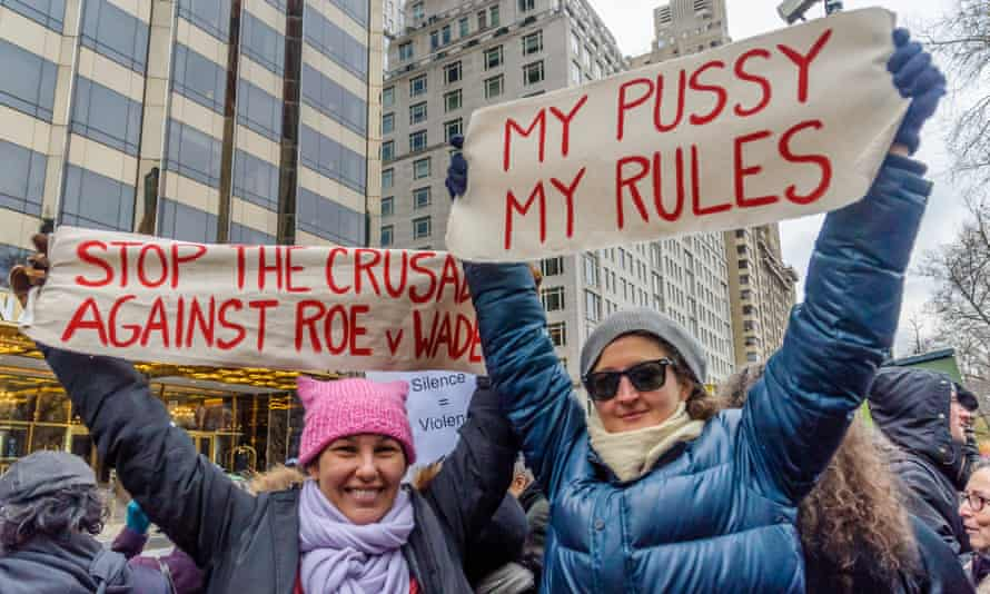 Women protest against Donald Trump's position on their rights on 12 December.