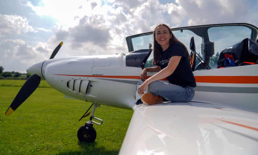 Zara Rutherford alongside a Shark ultralight aircraft at Popham airfield in Winchester, Hampshire.