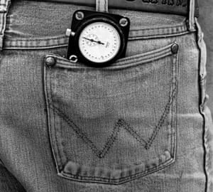 Car owner Junior Johnson's stop watch sticks out of the back pocket of his Wrangler jeans during qualifying for 1983 Daytona 500.