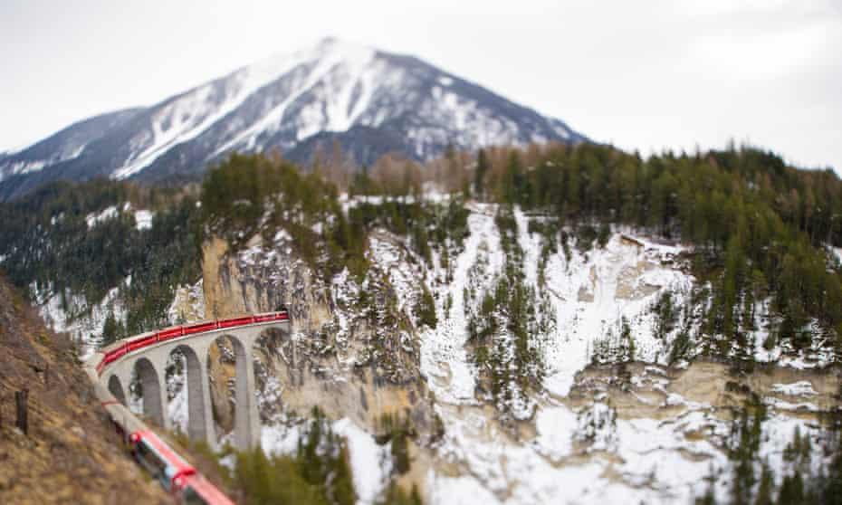 The red Bernina Express train on the Landwasser viaduct, Engadine, Switzerland.