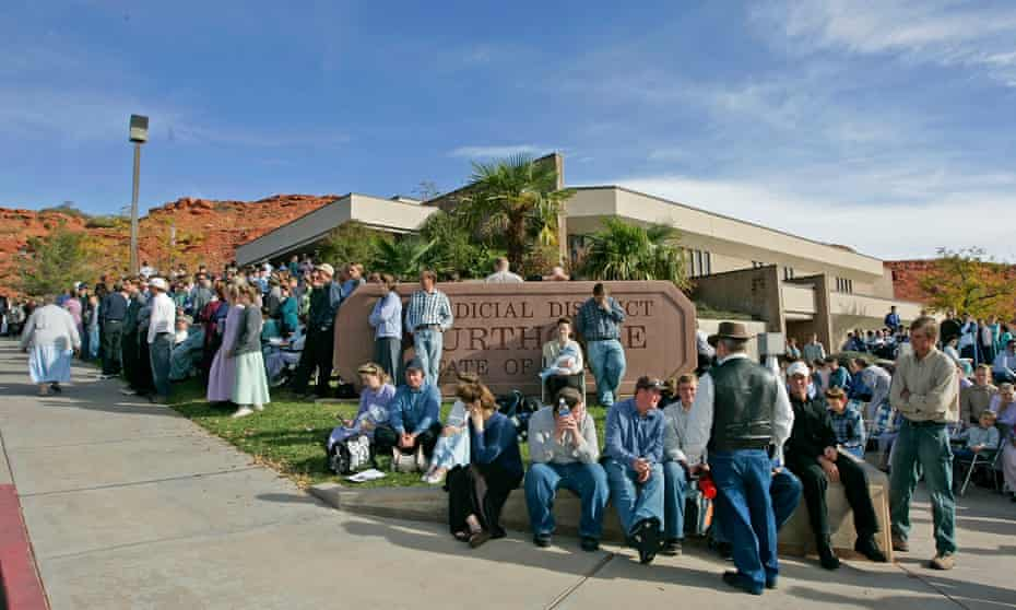 Polygamy supporters from Colorado City, Arizona, gather at the Fourth District courthouse in St George, Utah in 2008.