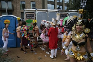 Performers prepare to take to the streets