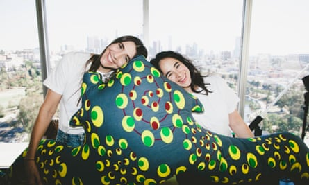 Iris Alonzo and Carolina Crespo from Everybody, with their body pillow, designed by art collector Jean Pigozzi.