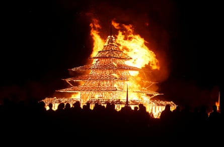 Participants watch the Temple Project burn on Sunday night.