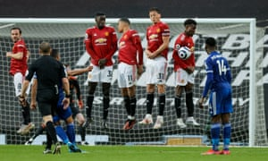 Youri Tielemans of Leicester City takes a free kick which is blocked by the Manchester United wall.