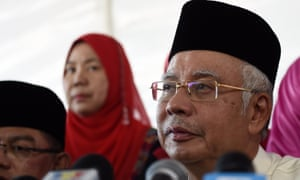 Najib Razak addresses the media at a mosque on the outskirts of Kuala Lumpur on July 5, 2015. He is threatening to sue the Wall Street Journal.