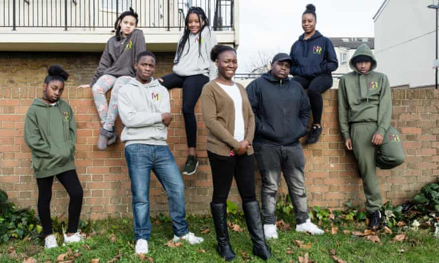 Magdalene Adenaike, founder of the Music Relief Foundation, and teenagers in Croydon