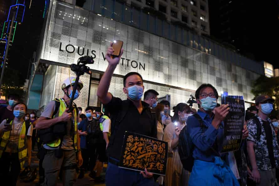 Demonstrators mark the first anniversary of the mass protest against the extradition bill in Hong Kong on 10 June 2020. The government was already chipping away at freedoms and the national sec urity law introduced later that month put an end to most street protests.