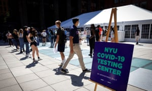 People wear masks as they wait in line at a Covid-19 testing site for returning students, faculty and staff at New York University.