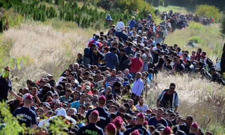 Police direct migrants through the Hungarian countryside in September 2015.