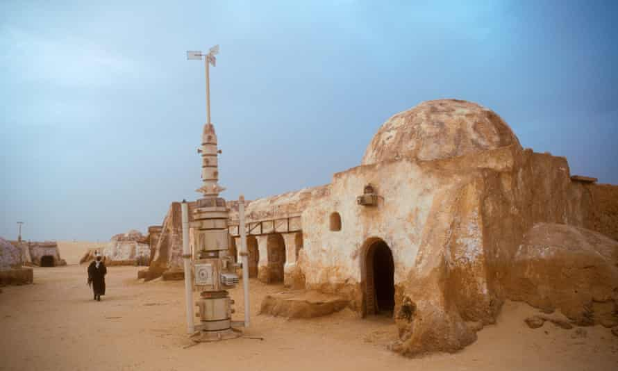 Arab man walking in the remains of the Star Wars set now a tourist attraction in the desert Tunisia AfricaAXFJB2 Arab man walking in the remains of the Star Wars set now a tourist attraction in the desert Tunisia Africa