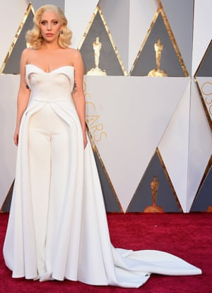 Gaga scores a red carpet first with a dress* with its very own camel toe.*it's technically more of a strapless jumpsuit with a train. And it's very Little White Wedding Chapel.