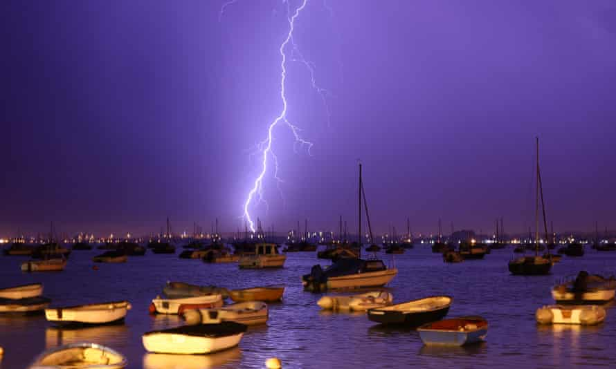 Poole harbour, Dorset, on 21 July. More storms with lightning and gusty winds are forecast.