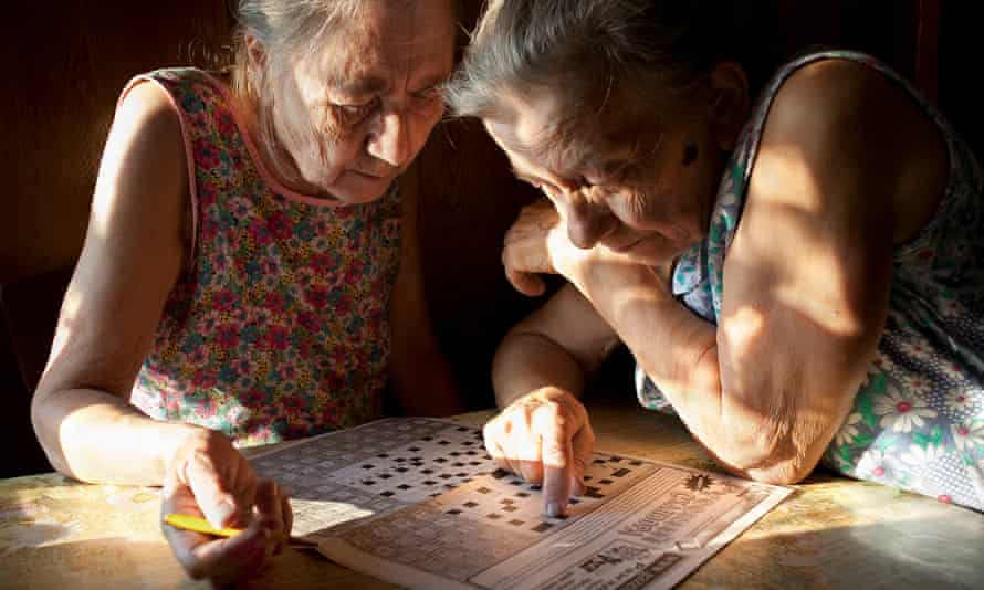 'It's hard to imagine they'll one day be gone' … the sisters complete a crossword in an image from the photobook Aunties. All photographs: Nadia Sablin