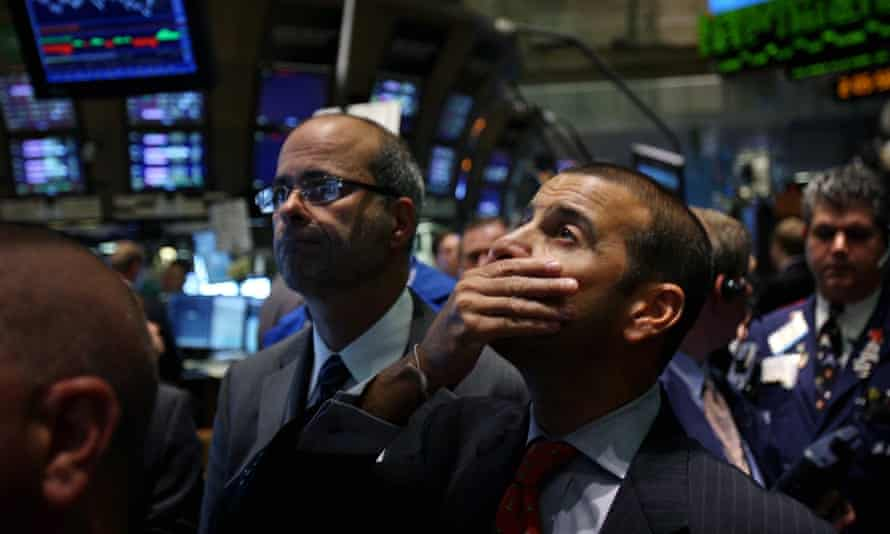 Traders look on at the New York stock exchange during the financial crisis