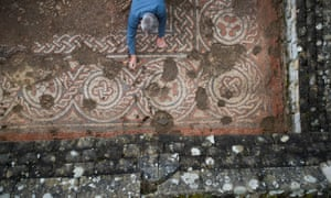An archaeologist works on the mosaic at Chedworth Roman villa.
