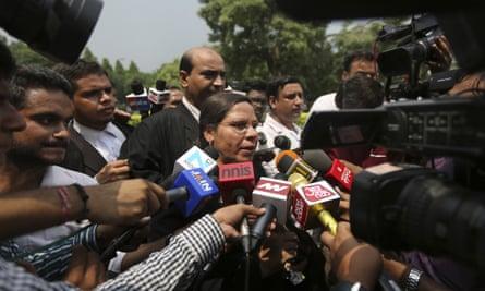 Farha Faiz, a supreme court lawyer, speaks to media after the declaration.