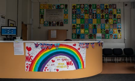 Signs supporting the NHS adorn the reception desk at a closed school.