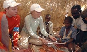 With his mother Mia on a Unicef mission to Sudan in 2004.
