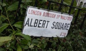 Sign for Albert Square among leaves