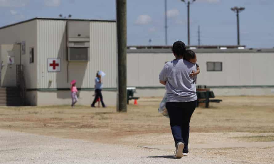 Immigrants seeking asylum walk through the detention center in Dilley, Texas.