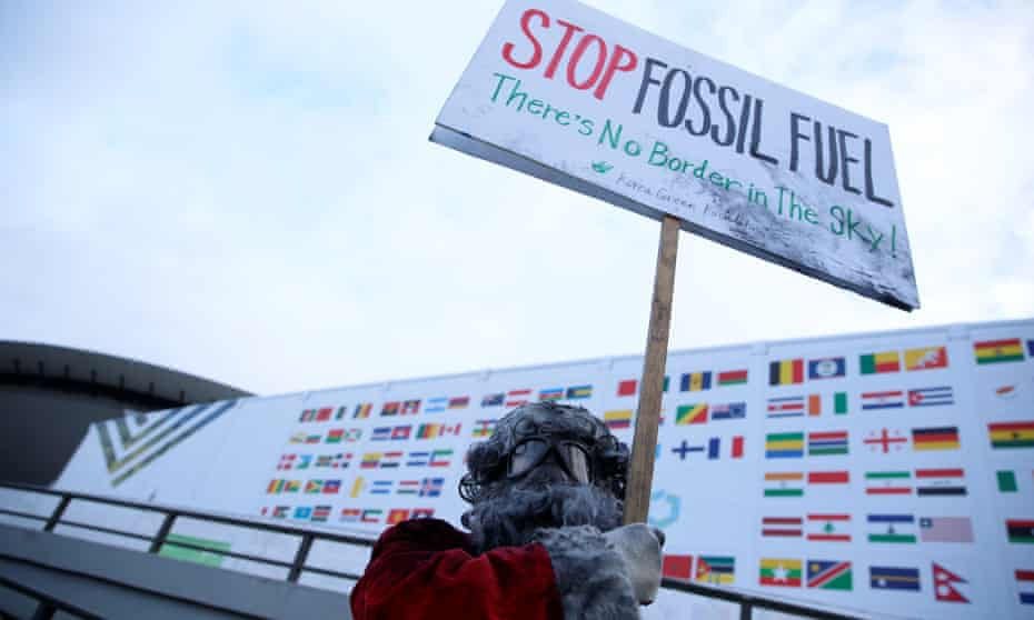 Environmental activist protests against fossil fuel at a climate conference in Poland.