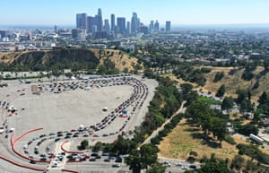 Drivers queue to be tested for Covid-19 in a car park at Dodger Stadium in Los Angeles on Friday