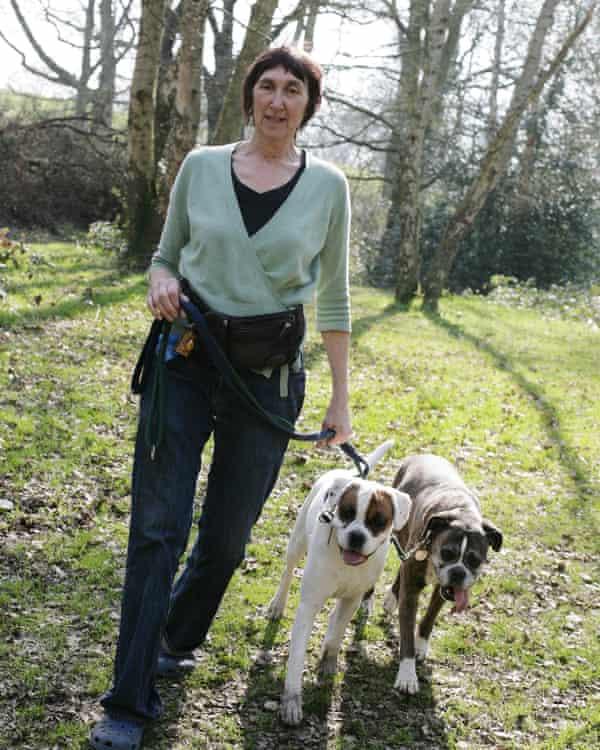 Michele Hanson walking her dogs on Hampstead Heath, London.